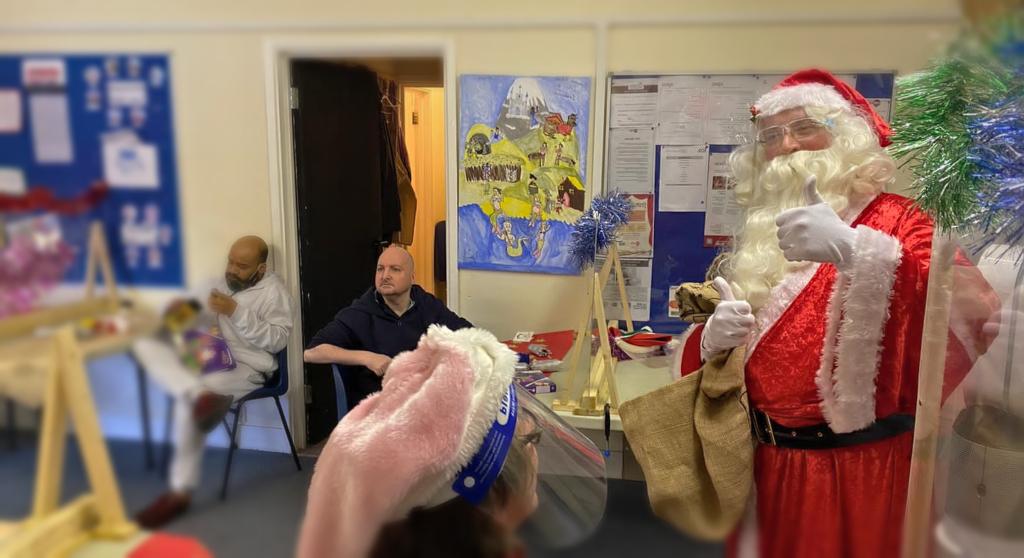 Santa Claus visits Greenwich Mencap members